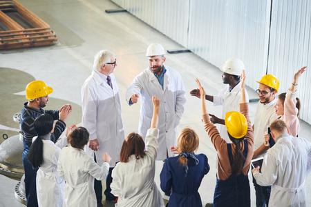 Photo pour Factory Managers Talking to Workers - image libre de droit
