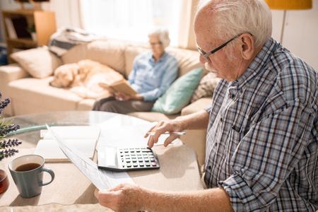Photo pour Senior Man Filling Forms - image libre de droit
