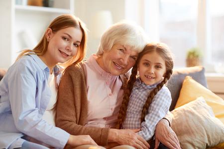 Photo pour Grandmother Posing with Family - image libre de droit
