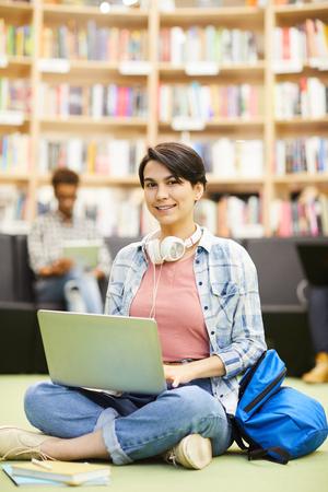 Photo pour Student girl using online resource on laptop - image libre de droit