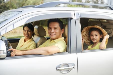 Photo pour Cheerful family riding in car - image libre de droit