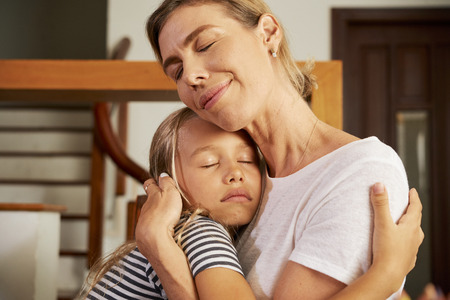 Photo for Girl hugging mother - Royalty Free Image