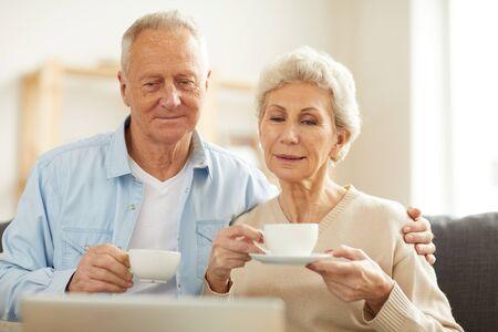 Photo pour Senior Couple Watching Videos - image libre de droit