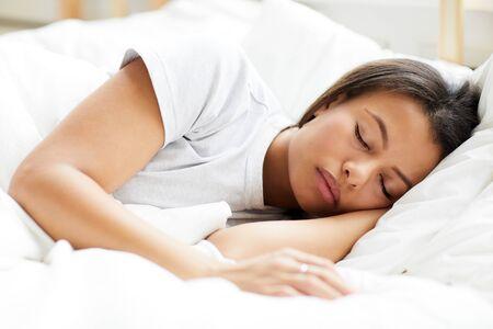 Photo pour Mixed-Race Woman Sleeping - image libre de droit
