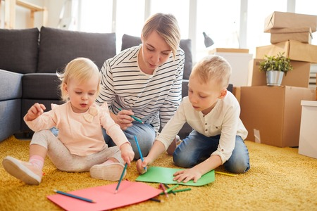 Photo for Mother teaching children to draw - Royalty Free Image