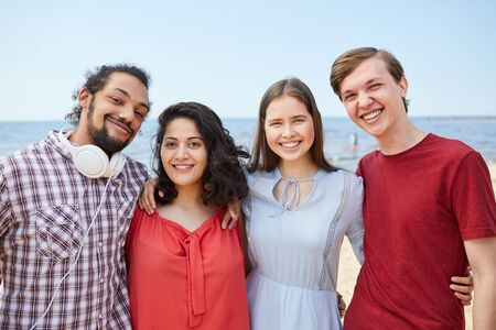 Photo pour Four Friends Posing by Sea - image libre de droit