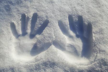 Photo pour two hands print on snowflake - image libre de droit