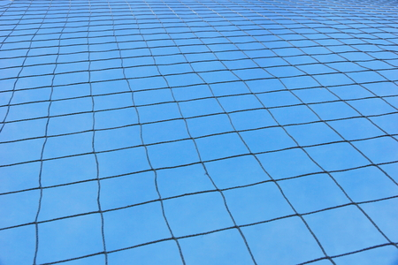 grid at the stadium against the blue sky. game of football