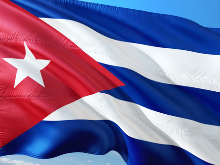 Photo pour Flag of Cuba waving in the wind against deep blue sky. High quality fabric. - image libre de droit