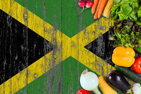 Photo pour Fresh vegetables from Jamaica on table. Cooking concept on wooden flag background. - image libre de droit