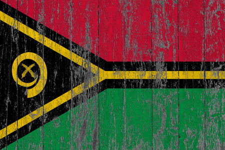 Flag of Vanuatu painted on worn out wooden texture background.