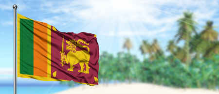 Photo pour Waving Sri Lanka flag in the sunny blue sky with summer beach background. Vacation theme, holiday concept. - image libre de droit