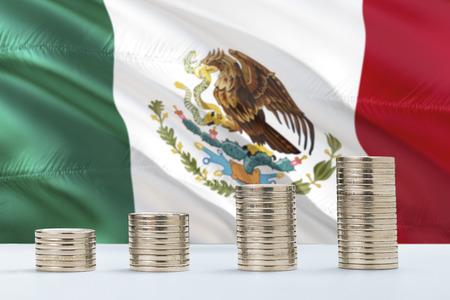 Foto de Mexico flag waving in the background with rows of coins for finance and business concept. Saving money. - Imagen libre de derechos