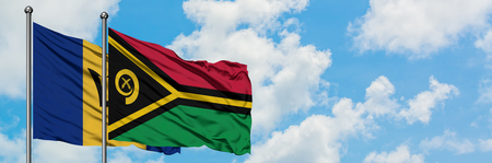 Barbados and Vanuatu flag waving in the wind against white cloudy blue sky together. Diplomacy concept, international relations.