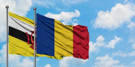 Photo pour Brunei and Romania flag waving in the wind against white cloudy blue sky together. Diplomacy concept, international relations. - image libre de droit