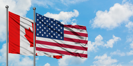 Photo pour Canada and United States flag waving in the wind against white cloudy blue sky together. Diplomacy concept, international relations. - image libre de droit