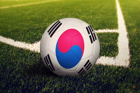 Photo pour South Korea flag on ball at corner kick position, soccer field background. National football theme on green grass. - image libre de droit
