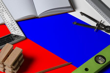 Photo pour Russia national flag on profession concept with architect desk and tools background. Top view mock-up. - image libre de droit