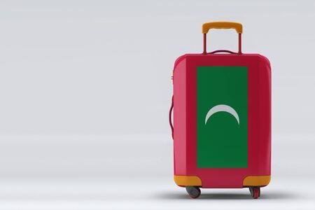 Photo pour Maldives flag on a stylish suitcases back view on color background. Space for text. International travel and tourism concept. 3D rendering. - image libre de droit