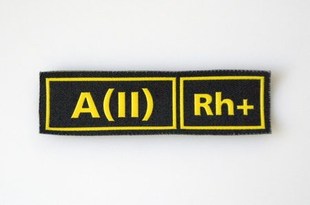 The badge with blood group and Rh factor