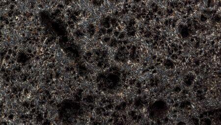 Dark rough stone surface background