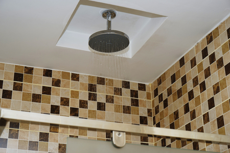 Detail of modern ceiling shower in the bathroom.