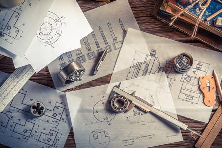 Photo pour Designing mechanical parts by engineer - image libre de droit