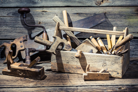 Wooden carpenters box with tools