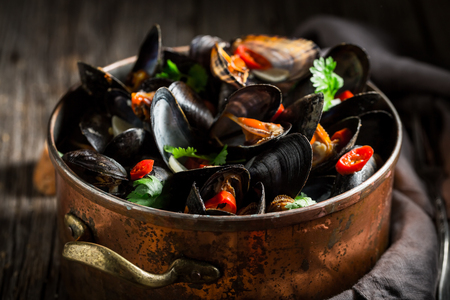 Photo for Enjoy your mussels with coriander and chili peppers - Royalty Free Image