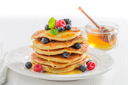 Photo pour American pancakes for breakfast in the morning on white background - image libre de droit