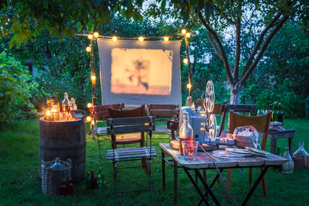 Photo for Open-air cinema with drinks and popcorn in the garden - Royalty Free Image