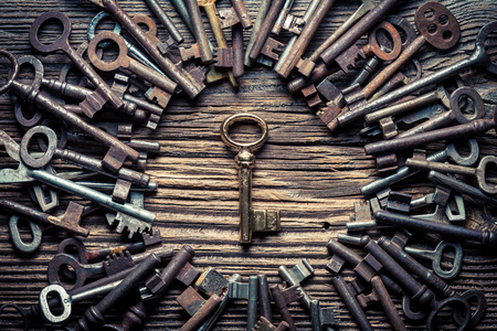 Foto de Many metal keys and one golden key as concept - Imagen libre de derechos