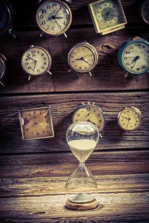 Hourglass as the old way of timing on clocks backgrounds
