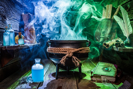 Photo for Witcher cauldron with magic potions and books for Halloween - Royalty Free Image