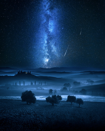 Photo for Milky way and falling stars over valley in Italy - Royalty Free Image
