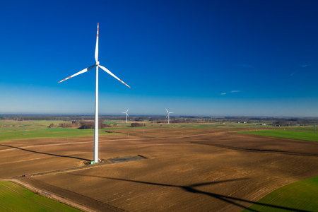 Photo for Flying above ecological wind turbines in a field - Royalty Free Image