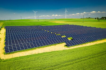 Photo for Amazing view of solar panels and wind turbines in summer - Royalty Free Image