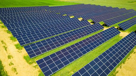 Photo for Stunning solar panels on green field, aerial view, Poland - Royalty Free Image