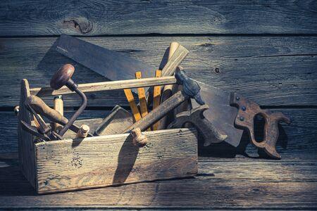 Foto de Vintage carpenters box with tools on rustic wooden table - Imagen libre de derechos