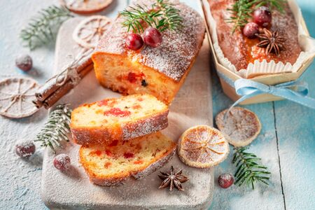 Foto de Traditionally Fruitcake for Christmas decorated with sugar powder - Imagen libre de derechos