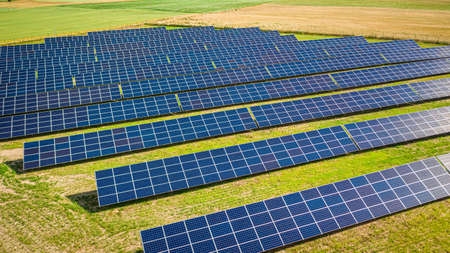 Photo for Aerial view of solar panels on green field in Poland, Europe - Royalty Free Image