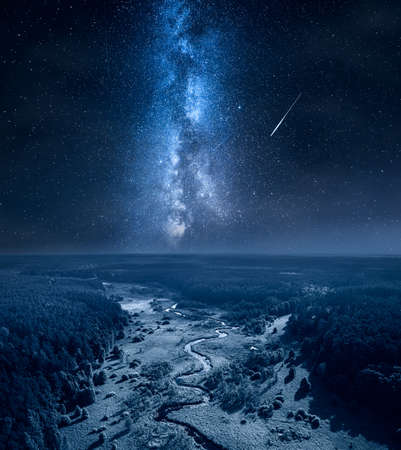 Milky way and falling stars over curvy river and swamps. Nature in Poland