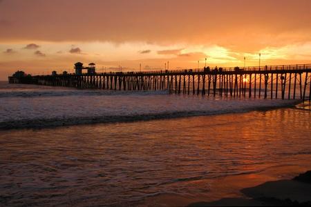Orange sunset at Oceanside pier in California