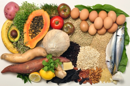 Layout of wide selection of wholesome healthy foods on white