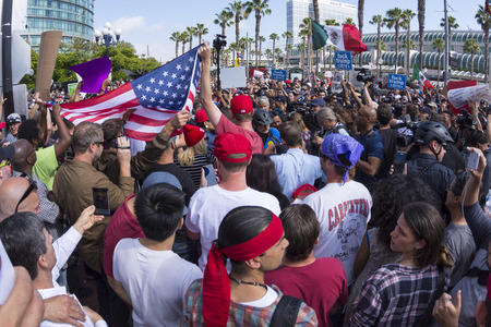 SAN DIEGO, USA - MAY 27, 2016: Tensions rise as anti-Trump protesters meet Trump supporters and American and Mexican flags are held up representing each group at a Donald Trump rally at the San Diego Convention Center.