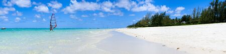 Tropical paradise. White sand beach turquoise ocean and blue sky.