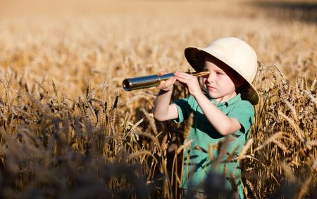 Portrait of young nature explorer in wheat field