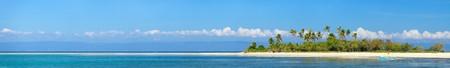 Panoramic photo of perfect tropical island in ocean