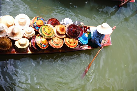 Vendor on Damnoen Saduak Floating Market near Bangkok in Thailand