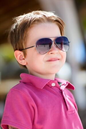 Portrait of cute 5 years old boy wearing sunglasses